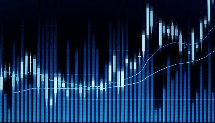 Stock market candle graph analysis on screen.
